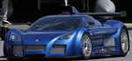Gumpert Apollo - The Apollo is a 2,400 lb to 2,600 lb (depending on options), street-legal race car. in blue