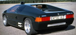 Isdera Imperator 108i - 420hp 6.0-liter AMG V8, rear view and good shot of the exhaust out the side